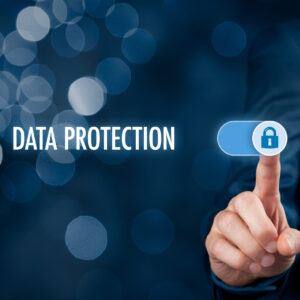 Data protection concept. Businessman click on button to activate data protection.